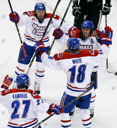Chad Ruhwedel, Josh Holmstrom, A.J. White, Zack Kamrass UMASS Lowell's A.J. White (18) celebrates his goal with teammates Josh Holmstrom, right, Chad Ruhwedel (3) and Zack Kamrass (27) in the third period of an NCAA Hockey East semi-final game against Providence in Boston, . UMASS Lowell won 2-1
