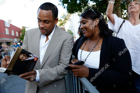 Hill Harper Hill Harper, left, autographs a copy of his book for a fan at an event marking the 10th anniversary of Hope Village for Children, a residential group home for abused and neglected children, founded by actress Sela Ward in her hometown of Meridian, Miss