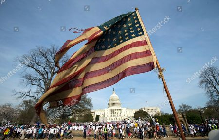 About 150 years old American flag is flown during a rally for immigration reform at the U.S. Capitol in Washington, . The owner Jimmy Castro, who was born in Alexandria, Va., said that the flag was bought by his great great grandfather Jaime Castro who came to California from Honduras. He moved to Illinois and three years later since he first came to United States he was naturalized. Jaime Castro bought the flag then when he bacame American citizen and the flag was passed on to the generations of Jaime Castros in the U.S. He has a son Jaime whom he said will inherit the flag