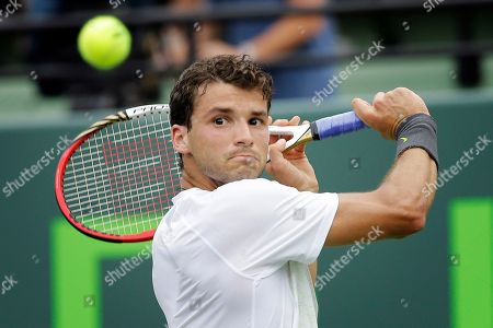 Andy Murray, Grigor Dimitrov Grigor Dimitrov, of Bulgaria, returns the ball to Andy Murray, from Great Britain, during the Sony Open Tennis tournament in Key Biscayne, Fla