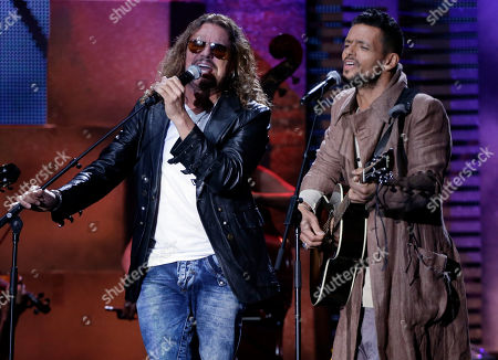 Stock Picture of Mana Fher Olvera of Mana performs with Robi Draco Rosa, right, at the Latin Billboard Awards in Coral Gables, Fla