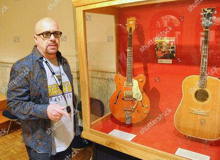 Stock Photo of LEGENDARY GUITARS This photo shows guitarist Robert Johnson, who played in the 1970s with Isaac Hayes and John Entwistle's Ox, talking about the Chet Atkins and Johnny Cash guitars he donated to the National Music Museum in Vermillion, S.D. Johnson also donated a guitar played by Elvis Presley during his final tour and a harmonic played by Bob Dylan