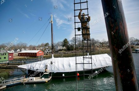 Jenny Baxter Jenny Baxter applies tar to the rigging on the schooner Mary Day, Friday, April, 5, 2013, in Camden, Maine. The crew member began her task 70-feet above the water. The Mary Day, a 90-foot windjammer built specifically for passenger cruises, will kick off its 51st summer sailing season in late May. The ketch Angelique undergoes offseason maintenance in the background
