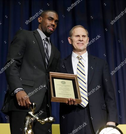 John Beilein, Tim Hardaway Jr Michigan junior Tim Hardaway Jr., stands with head coach John Beilein after receiving the Rudy Tomjanovic Most Improved Player award presented during an NCAA college basketball banquet at Crisler Center in Ann Arbor, Mich