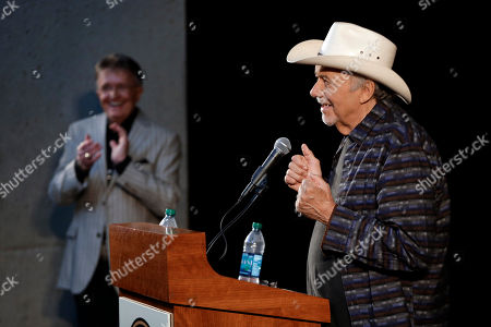 Bobby Bare, Bill Anderson Bobby Bare, right, is applauded by Bill Anderson, left,, in Nashville, Tenn., during the announcement of the newest inductees into the Country Music Hall of Fame. Bare will be inducted with Kenny Rogers and Jack Clement