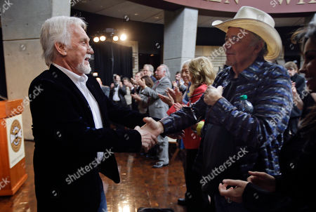 Bobby Bare, Kenny Rogers Kenny Rogers, left, shakes hands with Bobby Bare, right, after Rogers spoke, in Nashville, Tenn., during the announcement of the newest inductees into the Country Music Hall of Fame. Rogers and Bare will be inducted along with Jack Clement