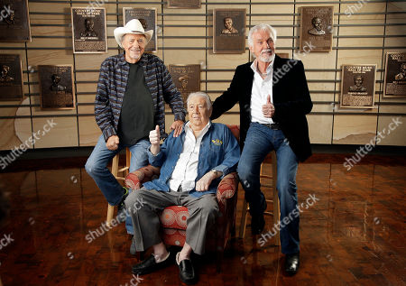 Bobby Bare, Kenny Rogers, Jack Clement Bobby Bare, left, Jack Clement, center, and Kenny Rogers, right, pose for photographers in the Country Music Hall of Fame, in Nashville, Tenn., after it was announced that they will be the newest inductees
