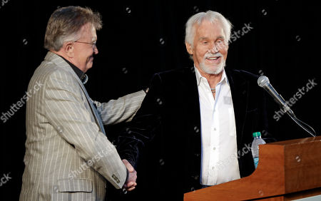 Bobby Bare, Kenny Rogers, Jack Clement Kenny Rogers, right, is introduced by Bill Anderson, in Nashville, Tenn., during the announcement of the newest inductees into the Country Music Hall of Fame. Rogers will be inducted with Bobby Bare and Jack Clement