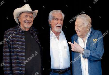 Bobby Bare, Kenny Rogers, Jack Clement Bobby Bare, left, Kenny Rogers, and Jack Clement, right, pose for photographers, in Nashville, Tenn., after it was announced that they will be inducted into the Country Music Hall of Fame