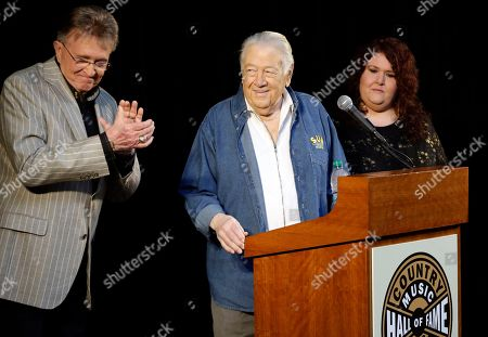 Bill Anderson, Jack Clement, Alison Clement Jack Clement, center, is applauded by Bill Anderson, left, after it was announced, in Nashville, Tenn., that Clement will be inducted into the Country Music Hall of Fame. At right is Clement's daughter, Alison Clement