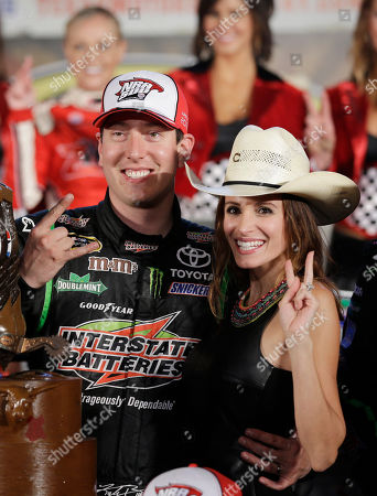 Kyle Busch, Samantha Busch Sprint Cup Series's Kyle Busch and his wife, Samantha Busch, celebrate after winning the NASCAR Sprint Cup series NRA 500 auto race and Friday's National series race at Texas Motor Speedway, in Fort Worth, Texas