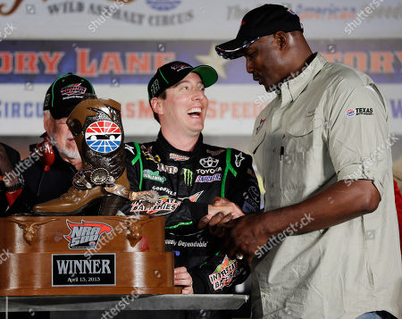 Stock Image of Kyle Busch, Karl Malone Former professional basketball player Karl Malone, right, presents the trophy after Sprint Cup Series's Kyle Busch won the NASCAR Sprint Cup series NRA 500 auto race at Texas Motor Speedway, in Fort Worth, Texas