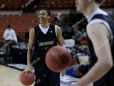 Spencer Dinwiddie Colorado's Spencer Dinwiddie, left, during practice for a second-round game of the NCAA college basketball tournament, in Austin, Texas. Colorado is scheduled to play Illinois on Friday