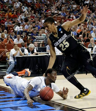 D.J. Richardson, Spencer Dinwiddie Illinois' D.J. Richardson, left, loses the ball out of bounds as he falls while Colorado's Spencer Dinwiddie (25) defends during the second half of a second-round game of the NCAA college basketball tournament, in Austin, Texas. Illinois beat Colorado 57-49