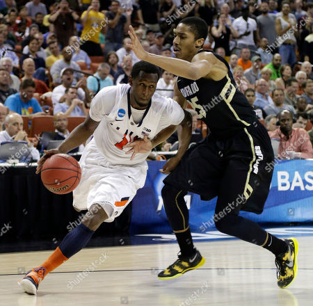 D.J. Richardson, Spencer Dinwiddie Illinois' D.J. Richardson (1) drives around Colorado's Spencer Dinwiddie (25) during the second half of a second-round game of the NCAA college basketball tournament, in Austin, Texas. Illinois beat Colorado 57-49