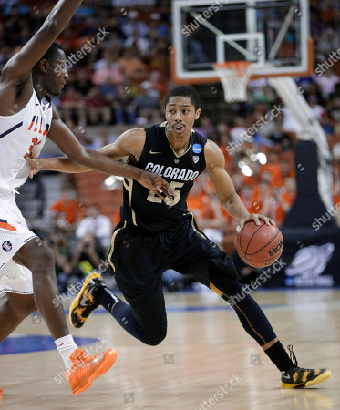 Nnanna Egwu, Spencer Dinwiddie Colorado's Spencer Dinwiddie (25) drives around Illinois' Nnanna Egwu during the second half of a second-round game of the NCAA men's college basketball tournament, in Austin, Texas. Illinois won 57-49
