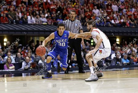 Seth Curry, Luke Hancock Duke's Seth Curry (30) drives to the basket under pressure from Louisville's Luke Hancock (11) during the second half of the Midwest Regional final in the NCAA college basketball tournament, in Indianapolis