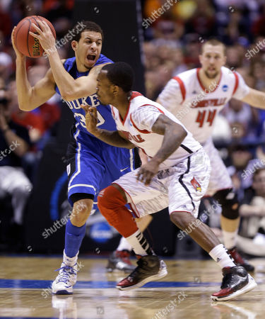 Seth Curry, Russ Smith Duke guard Seth Curry (30) tries to pass the ball against Louisville guard Russ Smith (2) during the first half of the Midwest Regional final in the NCAA college basketball tournament, in Indianapolis. Duke won 85-63 to advance to the Final Four