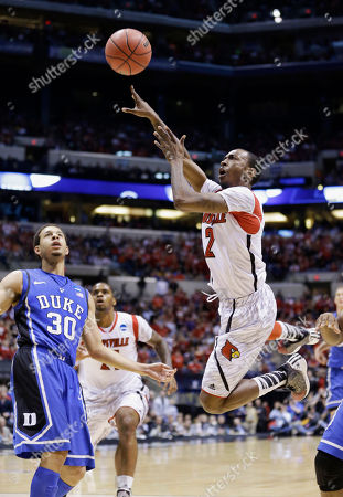 Russ Smith, Seth Curry Louisville guard Russ Smith (2) takes a shot in front of Duke guard Seth Curry (30) during the first half of the Midwest Regional final in the NCAA college basketball tournament, in Indianapolis