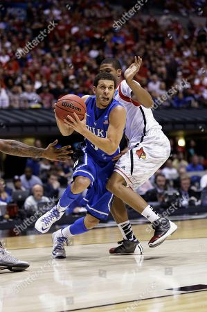 Seth Curry Duke's Seth Curry (30) drives past a Louisville defender during the second half of the Midwest Regional final in the NCAA college basketball tournament, in Indianapolis