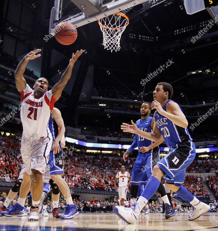 Chane Behanan, Seth Curry Louisville forward Chane Behanan (21) goes after a loose ball in front of Duke's Seth Curry (30) during the first half of the Midwest Regional final in the NCAA college basketball tournament, in Indianapolis. Louisville won 85-63 to advance to the Final Four