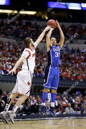 Seth Curry, Luke Hancock Duke's Seth Curry (30) shoots under pressure from Louisville's Luke Hancock during the second half of the Midwest Regional final in the NCAA college basketball tournament, in Indianapolis