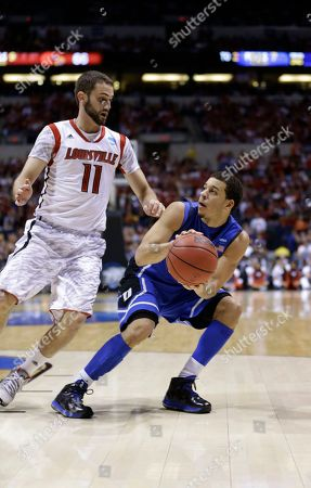 Seth Curry, Luke Hancock Duke's Seth Curry looks to shoot under pressure from Louisville's Luke Hancock (11) during the second half of the Midwest Regional final in the NCAA college basketball tournament, in Indianapolis
