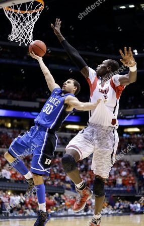 Seth Curry, Gorgui Dieng Duke guard Seth Curry (30) goes up for a shot against Louisville center Gorgui Dieng (10) during the second half of the Midwest Regional final in the NCAA college basketball tournament, in Indianapolis. Louisville won 85-63