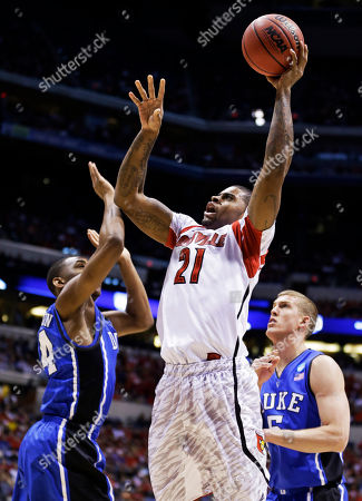 Chane Behanan, Rasheed Sulaimon, Mason Plumlee Louisville forward Chane Behanan (21) shoots under pressure from Duke guard Rasheed Sulaimon (14) and Duke forward Mason Plumlee (5) during the first half of the Midwest Regional final in the NCAA college basketball tournament, in Indianapolis