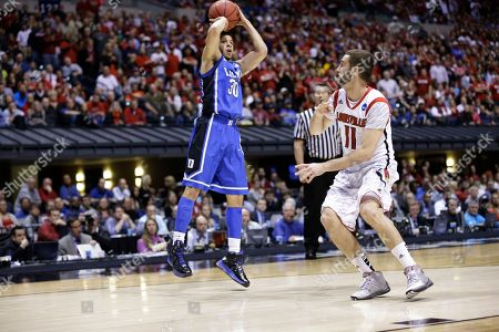 Seth Curry, Luke Hancock Duke's Seth Curry (30) puts up a shot over Louisville's Luke Hancock (11) during the second half of the Midwest Regional final in the NCAA college basketball tournament, in Indianapolis