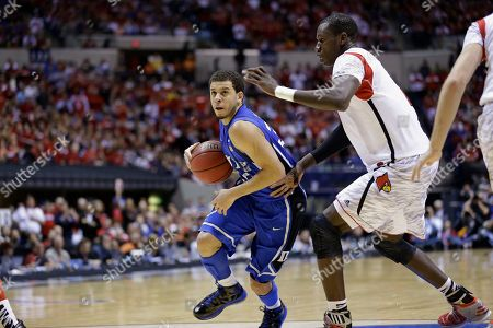 Seth Curry, Gorgui Dieng Duke's Seth Curry tries to drive around Louisville's Gorgui Dieng, right, during the second half of the Midwest Regional final in the NCAA college basketball tournament, in Indianapolis