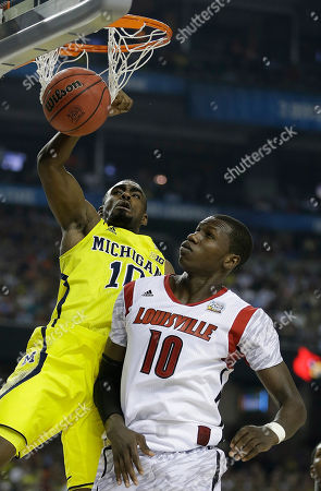 Michigan guard Tim Hardaway Jr. (10) dunks the ball over Louisville center Gorgui Dieng (10) during the second half of the NCAA Final Four tournament college basketball championship game, in Atlanta
