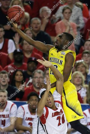 Michigan guard Tim Hardaway Jr. (10) shoots against Louisville guard/forward Wayne Blackshear (20) during the first half of the NCAA Final Four tournament college basketball championship game, in Atlanta