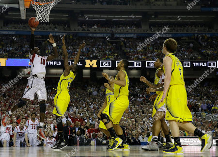 Louisville center Gorgui Dieng (10) shoots over Michigan guard Tim Hardaway Jr. (10) during the second half of the NCAA Final Four tournament college basketball championship game, in Atlanta