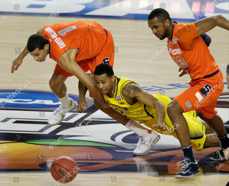 Syracuse's Michael Carter-Williams (1) Michigan's Trey Burke ( 3) and Syracuse's James Southerland (43) vie for a loose ball during the first half of the NCAA Final Four tournament college basketball semifinal game, in Atlanta