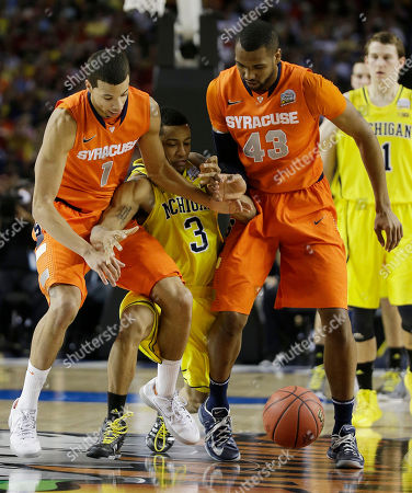 Syracuse's Michael Carter-Williams (1) and Syracuse's James Southerland (43) vie for a loose ball Michigan's Trey Burke (3) during the first half of the NCAA Final Four tournament college basketball semifinal game, in Atlanta