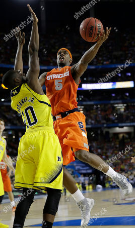 Syracuse's C.J. Fair (5) shoots over Michigan's Tim Hardaway Jr. (10) during the second half of the NCAA Final Four tournament college basketball semifinal game, in Atlanta