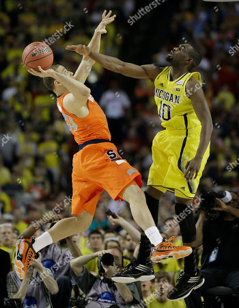 Syracuse's Brandon Triche (20) shoots against Michigan's Tim Hardaway Jr. (10) during the first half of the NCAA Final Four tournament college basketball semifinal game, in Atlanta
