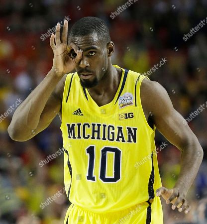 Michigan's Tim Hardaway Jr. (10) reacts after a Michigan 3-point shot against Syracuse during the second half of the NCAA Final Four tournament college basketball semifinal game, in Atlanta