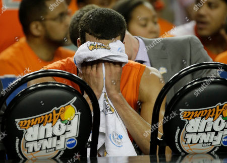 Syracuse's Michael Carter-Williams (1) sits on the bench during the second half of the NCAA Final Four tournament college basketball semifinal game against Michigan, in Atlanta
