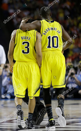 Michigan's Trey Burke, left and Michigan's Tim Hardaway Jr. walk down the court during the second half of the NCAA Final Four tournament college basketball semifinal game against Syracuse, in Atlanta