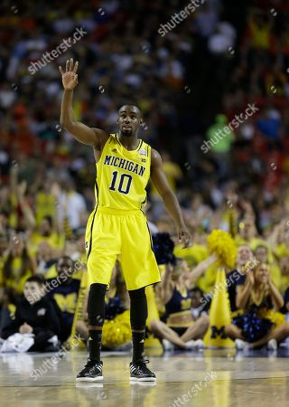 Tim Hardaway Jr Michigan's Tim Hardaway Jr. (10) watches during the first half of the NCAA Final Four tournament college basketball semifinal game against Syracuse, in Atlanta