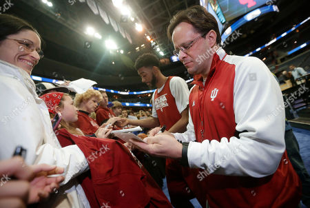 Tom Crean, Christian Watford Indiana coach Tom Crean, right, and forward Christian Watford, center, sign autographs following their practice for a regional semifinal in the NCAA men's college basketball tournament, in Washington. Indiana plays Syracuse on Thursday