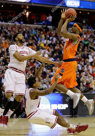 Stock Picture of C.J. Fair, Christian Watford,Yogi Ferrell Syracuse forward C.J. Fair (5) shoots over Indiana forward Christian Watford (2) and guard Yogi Ferrell (11) during the first half of an East Regional semifinal in the NCAA college basketball tournament, in Washington