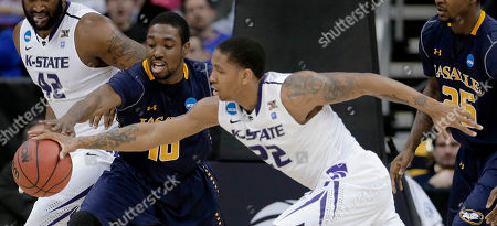 Sam Mills Kansas State guard Rodney McGruder (22) and La Salle guard Sam Mills (10) chase a loose ball during the first half of a second-round game of the NCAA men's college basketball tournament, in Kansas City, Mo