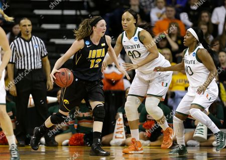 Morgan Johnson, Shawnice Wilson, Michelle Woods Iowa center Morgan Johnson, left, dribbles in front of Miami center Shawnice Wilson, center, and guard Michelle Woods, right, during the first half of a first-round game in the women's NCAA college basketball tournament, in Iowa City, Iowa