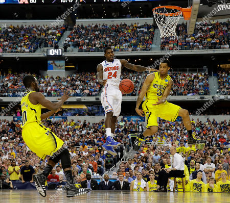 Tim Hardaway Jr., Casey Prather, Trey Burke Michigan's Trey Burke (3) passes the ball to Tim Hardaway Jr. (10) as Casey Prather (24) defends during the second half of a regional final game in the NCAA college basketball tournament, in Arlington, Texas