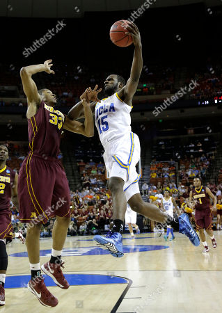Shabazz Muhammad, Rodney Williams UCLA's Shabazz Muhammad (15) goes up for a shot as Minnesota's Rodney Williams (33) defends during the second half of a second-round game of the NCAA college basketball tournament, in Austin, Texas. Minnesota won 83-63