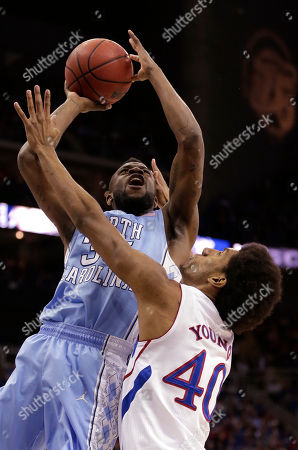 Reggie Bullock North Carolina guard/forward Reggie Bullock (35) shoots under pressure from Kansas forward Kevin Young (40) during the first half of a third-round game in the NCAA college basketball tournament, in Kansas City, Mo