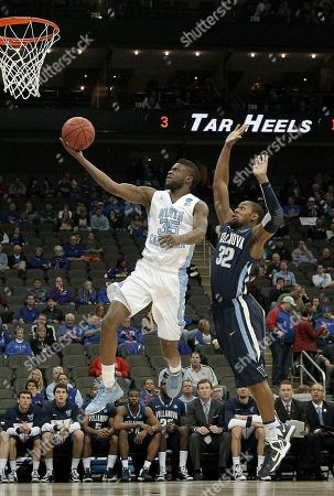 Reggie Bullock North Carolina guard/forward Reggie Bullock (35) gets past Villanova guard James Bell (32) to put up a shot during the first half of a second-round game in the NCAA college basketball tournament, in Kansas City, Mo